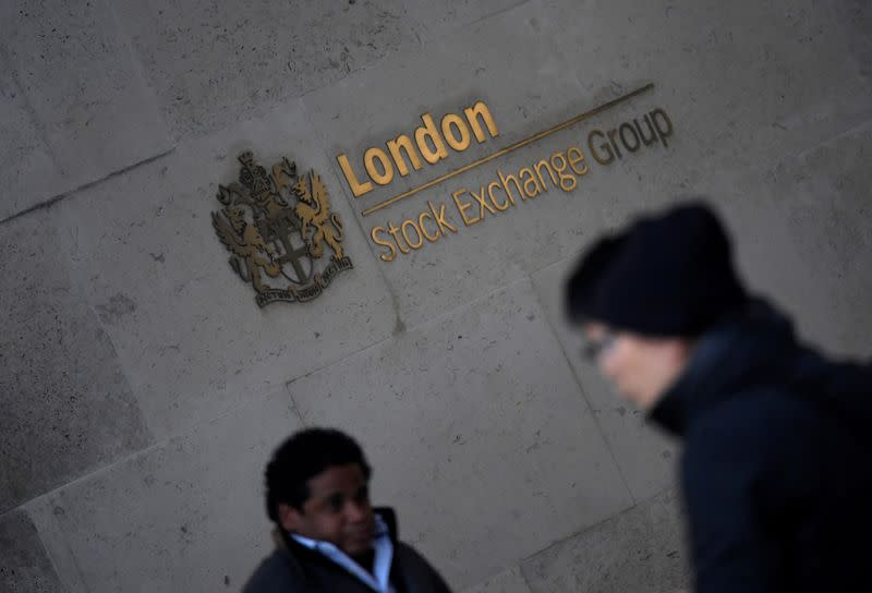 People walk past the London Stock Exchange Group offices in the City of London