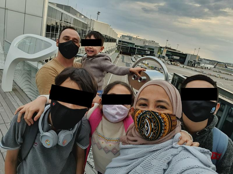 The Nelson family (above) was trapped inside Germany's Frankfurt am Main Airport after a transit policy oversight by a travel agent. This was their first taste of fresh air in four days. (The family asked that the children's faces be obscured.) (Photo: Rinnie Nelson )