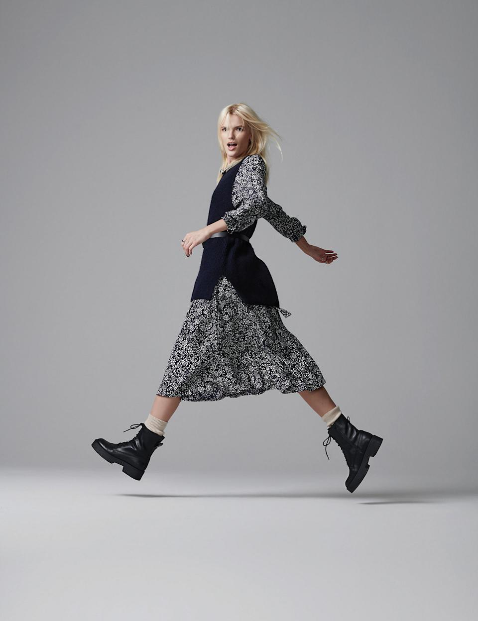 Marks and Spencer's Floral Midi Waisted Dress is a must have this Autumn/Winter, style it with trainers, army boots or heeled boots. (Marks and Spencer)