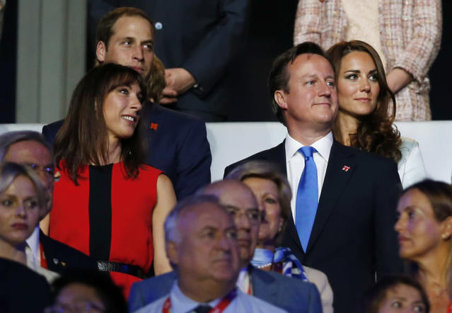 Britain's Prince William, the Duke of Cambridge, back left, and his wife Catherine, Duchess of Cambridge, back right, Britain's Prime Minister David Cameron, front right, and his wife Samantha, front left, watch the Opening Ceremony at the 2012 Summer Olympics, Friday, July 27, 2012, in London. (AP Photo/Matt Dunham)