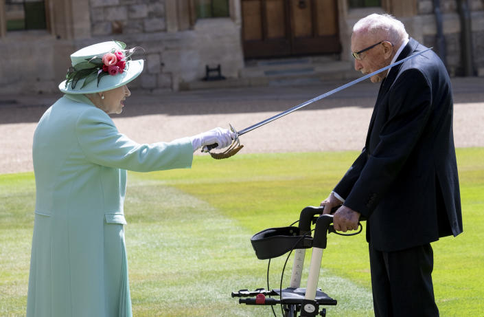 WINDSOR, ENGLAND - JULY 17: Queen Elizabeth II awards Captain Sir Thomas Moore with the insignia of Knight Bachelor at Windsor Castle on July 17, 2020 in Windsor, England. British World War II veteran Captain Tom Moore raised over £32 million for the NHS during the coronavirus pandemic. (Photo by UK Press Pool/UK Press via Getty Images)