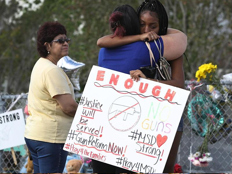 Tyra Heman, a senior at Marjory Stoneman Douglas High School, holds a sign that reads, 'Enough No Guns,' on 19 February 2018 in Parkland, Florida: Joe Raedle/Getty Images