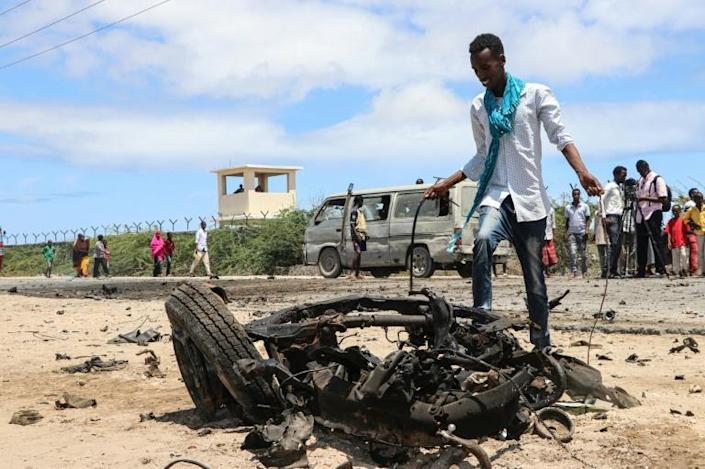 The twisted remains of a car bomb in Mogadishu that was targeted at EU military advisors (AFP Photo/Abdirazak Hussein FARAH)