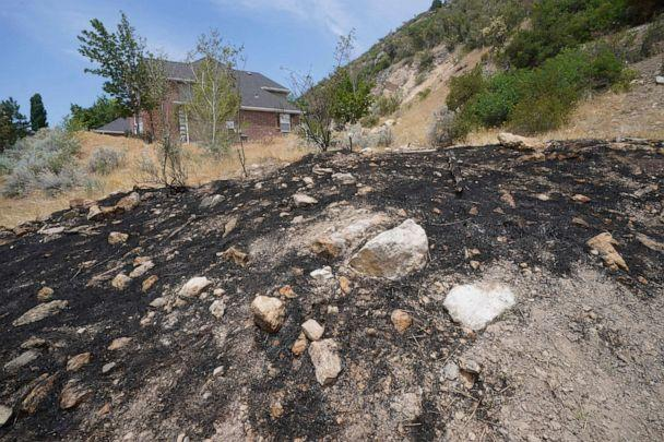 PHOTO: A burnt hillside caused by fireworks is shown June 22, 2021, in Provo, Utah. With a megadrought gripping the West, officials are enacting bans, canceling displays or begging people to be careful when lighting fireworks.  (Rick Bowmer/AP)