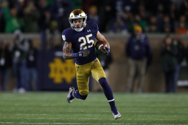 Notre Dame wide receiver Braden Lenzy runs for a 51-yard touchdown in the first half of an NCAA college football game against Southern California in South Bend, Ind., Saturday, Oct. 12, 2019. (AP Photo/Paul Sancya)