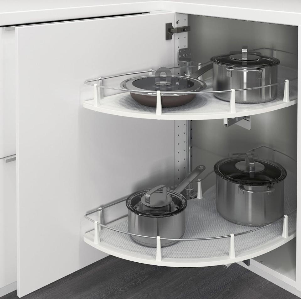 "<p>Access pots and pans with ease thanks to the <a href=""https://www.popsugar.com/buy/Utrusta%20Corner%20Base%20Cab%20Pull-Out-447008?p_name=Utrusta%20Corner%20Base%20Cab%20Pull-Out&retailer=ikea.com&price=139&evar1=casa%3Aus&evar9=46151613&evar98=https%3A%2F%2Fwww.popsugar.com%2Fhome%2Fphoto-gallery%2F46151613%2Fimage%2F46152197%2FUtrusta-Corner-Base-Cab-Pull-Out&list1=shopping%2Cikea%2Corganization%2Ckitchens%2Chome%20shopping&prop13=api&pdata=1"" rel=""nofollow noopener"" target=""_blank"" data-ylk=""slk:Utrusta Corner Base Cab Pull-Out"" class=""link rapid-noclick-resp"">Utrusta Corner Base Cab Pull-Out</a> ($139). Its sleek design will keep your cupboards clutter-free and organized, too.</p>"