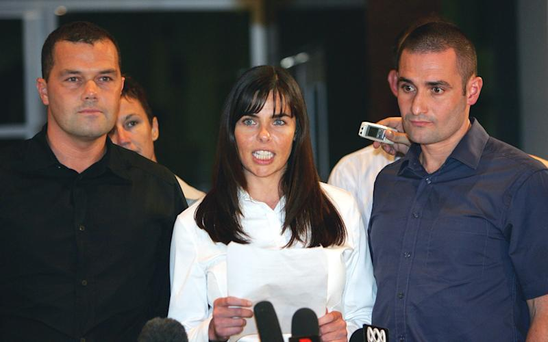Joanne Lees, with Peter Falconio's brothers Nick and Paul, speaks outside the Northern Territory Supreme Court in Darwin, Australia in 2005 - Credit: RICK STEVENS/AP