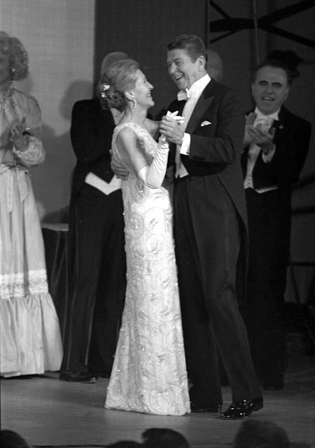 President Ronald Reagan and his wife, Nancy dance Jan. 20, 1981 at an inaugural ball at the Pension Building in Washington . The President and first lady were scheduled to appear at nine ball during the evening. (AP Photo)
