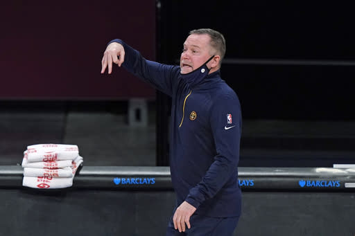 Denver Nuggets coach Michael Malone gestures during the second quarter of the team's NBA basketball game against the Brooklyn Nets, Tuesday, Jan. 12, 2021, in New York. (AP Photo/Kathy Willens)