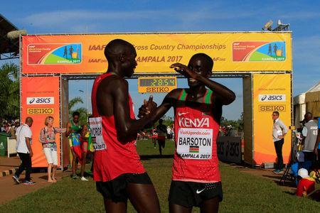Athletics - IAAF World Cross Country Championships - Senior Race Men - Kololo Independence Grounds, Kampala, Uganda - 26/03/17 - Gold medallist Kenya's Geoffrey Kipsang Kamworor (L) celebrates with team mate Leonard Kiplimo Barsoton after winning the race. REUTERS/James Akena