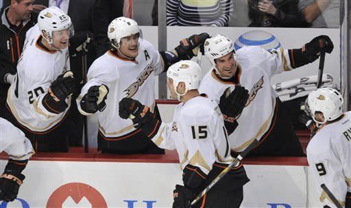Anaheim Ducks' bench celebrates after teammate Sheldon Souray scored against the Chicago Blackhawks during the third period of an NHL hockey game in Chicago, Friday, March, 29, 2013. Anaheim won 2-1. (AP Photo/Paul Beaty)