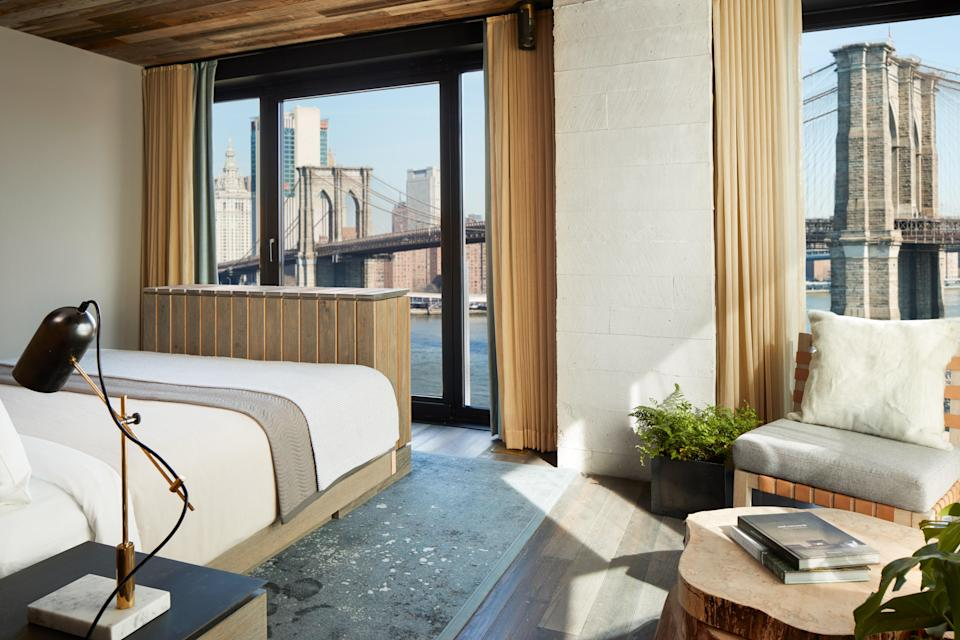 <p><strong>How did it strike you on arrival?</strong><br> Calm and cool, modern, and with a palette of serene neutrals, the 1 Hotel Brooklyn Bridge is meant to let the outdoors in, and accomplishes that with plenty of natural light and greenery (including lots of plants everywhere) and iconic DUMBO neighborhood views.</p> <p><strong>What's the crowd like?</strong><br> Gwyneth Paltrow was a guest at the hotel and documented the stay on her Instagram. Do with that information what you will..</p> <p><strong>Importantly: Tell us about your room.</strong><br> The all-natural theme extends to the guest quarters, where even the smallest rooms are a spacious, natural light-filled 300 square feet. Eco-warriors will love the sustainable touches, like water glasses made from recycled bottles, reclaimed wood bed frames, and organic cotton mattresses. Many rooms have stunning views of the Brooklyn Bridge.</p> <p><strong>We're craving some deep, restorative sleep. They got us?</strong><br> The organic cotton mattress and sheets and corrugated leather headboard make for a special and comfortable night's sleep.</p> <p><strong>How about the little things, like mini bar, or shower goodies. Any of that worth a mention?</strong><br> The water glasses, made from recycled green bottles, aren't only eco-friendly, but so pretty (we'd love them in our own kitchen), as are the pendent leather lampshades.</p> <p><strong>Please tell us the bathroom won't let us down.</strong><br> Mahogany, glass, and marble make up the gorgeous bathrooms, which features a triple-filtered rain shower and all natural bath products.</p> <p><strong>We could all use some good Wi-Fi. What's the word on that?</strong><br> Fast, free Wi-Fi.</p> <p><strong>Anything stand out about other services and features? Whether it's childcare, gyms, spas, even parking—whatever stuck with you.</strong><br> The rooftop pool and Harriet's garden lounge have amazing views out over Manhattan and <del>is</del> are where you'll want to 