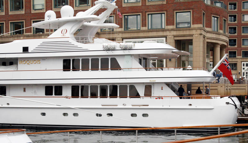 "Police work aboard Boston Red Sox owner John Henry's yacht ""Iroquois,"" moored at Rowes Wharf in Boston, Monday, June 3, 2013. The police are investigating what appears to be a suicide on the yacht. Police spokeswoman Cheryl Fiandaca says that the victim is a man 28 to 30 years old. (AP Photo/Bill Sikes)"
