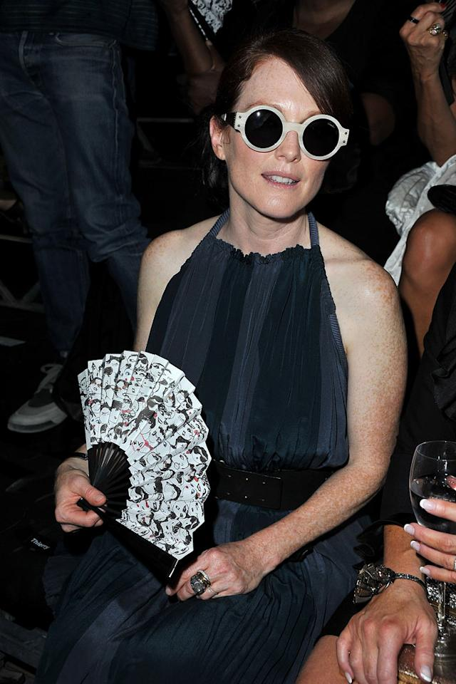 """And last, but certainly not least ... four-time Oscar nominee Julianne Moore, who donned these shades to the Lanvin presentation at Paris Fashion Week. Chic or silly? Discuss!   Check out last week's gallery <a href=""""http://omg.yahoo.com/photos/what-were-they-thinking/5227"""">here!</a>   Follow What Were They Thinking?! creator, <a href=""""http://bit.ly/lifeontheMlist"""" target=""""new"""">Matt Whitfield</a>, on Twitter! Pascal Le Segretain/<a href=""""http://www.gettyimages.com/"""" target=""""new"""">GettyImages.com</a> - September 30, 2011"""