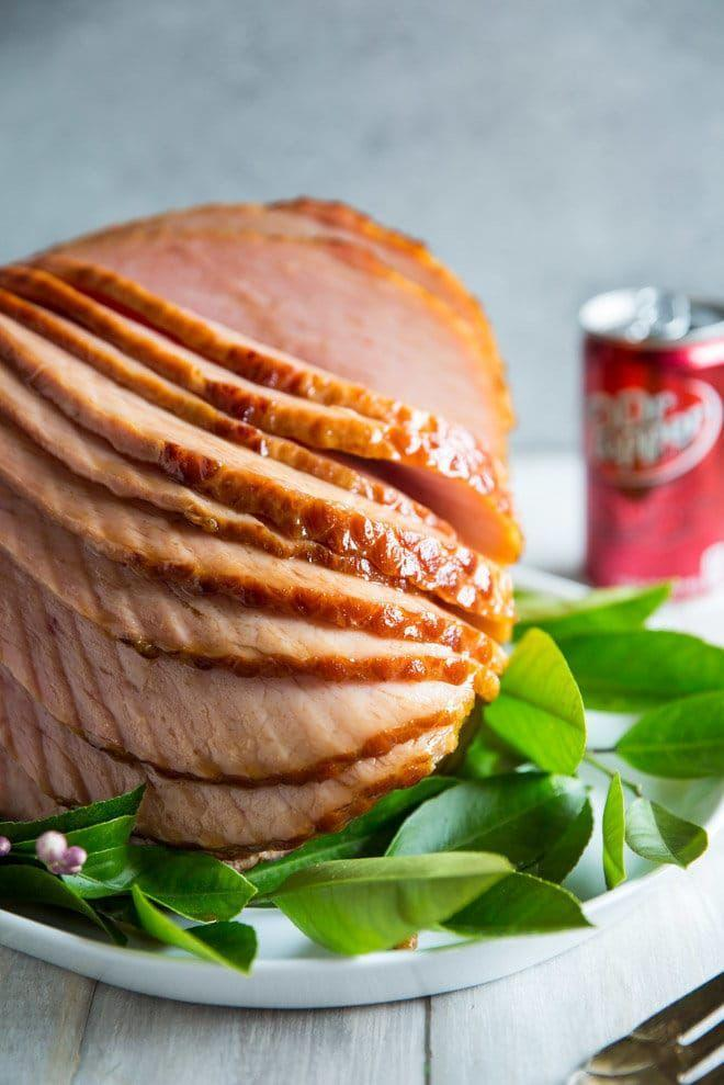 """<p>Here's an idea any Dr Pepper fan will love: Add the soft drink to your baked ham for an even stickier, sweeter glaze.</p><p><strong>Get the recipe at <a href=""""https://www.culinaryhill.com/dr-pepper-ham/"""" rel=""""nofollow noopener"""" target=""""_blank"""" data-ylk=""""slk:Culinary Hill"""" class=""""link rapid-noclick-resp"""">Culinary Hill</a>.</strong></p><p><strong><a class=""""link rapid-noclick-resp"""" href=""""https://go.redirectingat.com?id=74968X1596630&url=https%3A%2F%2Fwww.walmart.com%2Fbrowse%2Fhome%2Fserving-platters-trays%2F4044_623679_639999_2347672_7413764%3Ffacet%3Dbrand%253AThe%2BPioneer%2BWoman&sref=https%3A%2F%2Fwww.thepioneerwoman.com%2Ffood-cooking%2Fmeals-menus%2Fg34573457%2Fchristmas-ham-recipes%2F"""" rel=""""nofollow noopener"""" target=""""_blank"""" data-ylk=""""slk:SHOP PLATTERS"""">SHOP PLATTERS</a><br></strong></p>"""
