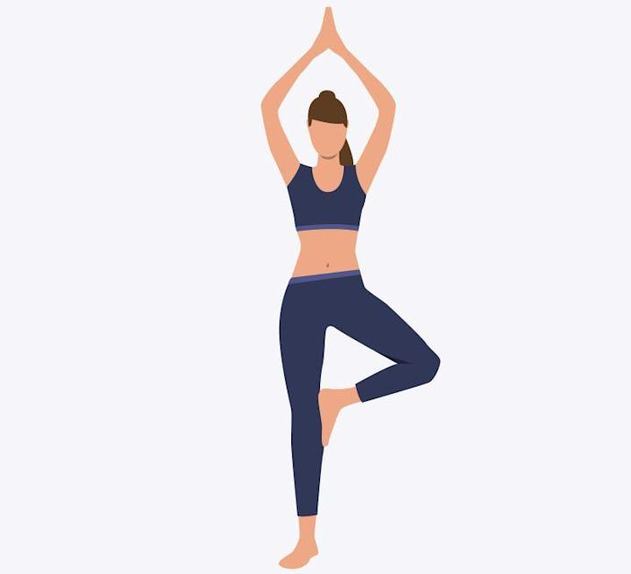 Woman standing in yoga position. Exercise, asana, balance. Can be used for topics like sport, healthy lifestyle, training.
