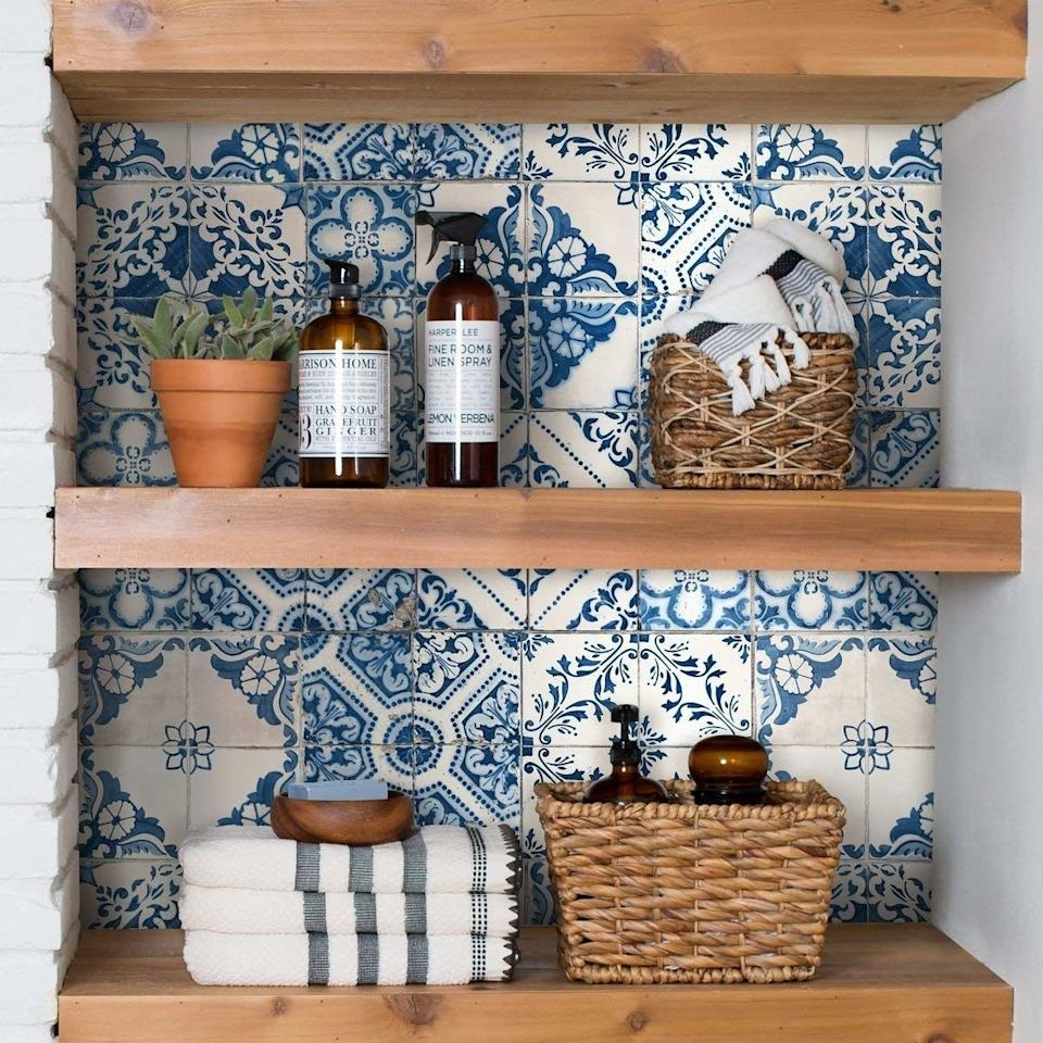 """This wallpaper is such an easy way to brighten up your home with a marvelous, Mediterranean tile touch.<br /><br /><strong>Promising review:</strong>""""I am IN LOVE. I bought this to use as a backsplash in my rented studio apartment kitchen, which has potential to be pretty but really needs some help. I ordered two rolls thinking that if I liked it in my kitchen, I'd order more to use on the wall behind my bar cart. I loved it so much when it came in that I decided to go ahead and put it up on the big wall and deal with the kitchen later.<strong>The pattern is so easy to line up and it looks so good! My tiny, dark apartment instantly looked bigger and brighter.</strong>Even up close I can't tell where the seams are. It was super easy to put up by myself, though I would recommend having another person to help if possible because it would have taken a lot less time if I'd had someone to hold it steady while I lined up the edges. If I could give six stars I would. It's expensive but worth every penny!"""" — <a href=""""https://www.amazon.com/gp/customer-reviews/R3P6MLISWTXWIG?&linkCode=ll2&tag=huffpost-bfsyndication-20&linkId=909e2b1589f87ccfeabe7fae26e36661&language=en_US&ref_=as_li_ss_tl"""" target=""""_blank"""" rel=""""nofollow noopener noreferrer"""" data-skimlinks-tracking=""""5854435"""" data-vars-affiliate=""""Amazon"""" data-vars-href=""""https://www.amazon.com/gp/customer-reviews/R3P6MLISWTXWIG?tag=bfmal-20&ascsubtag=5854435%2C8%2C37%2Cmobile_web%2C0%2C0%2C16324227"""" data-vars-keywords=""""cleaning"""" data-vars-link-id=""""16324227"""" data-vars-price="""""""" data-vars-product-id=""""20942021"""" data-vars-product-img="""""""" data-vars-product-title="""""""" data-vars-retailers=""""Amazon"""">Lizzy<br /><br /></a><strong>Get it from Amazon on sale for<a href=""""https://www.amazon.com/RoomMates-Mediterranian-Tile-Stick-Wallpaper/dp/B078SNQC7S?&linkCode=ll1&tag=huffpost-bfsyndication-20&linkId=9778d25bba3335568af646e18c6bc46e&language=en_US&ref_=as_li_ss_tl"""" target=""""_blank"""" rel=""""nofollow noopener noreferrer"""" data-skimlinks-tracking=""""585443"""