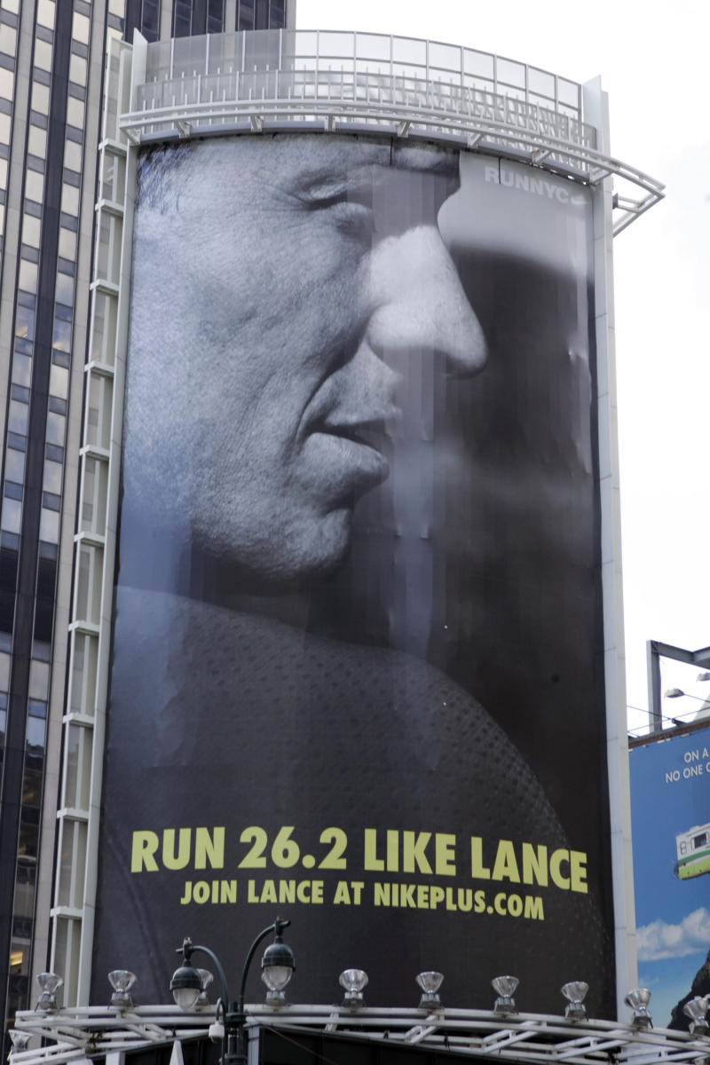 "FILE - In an 80-foot billboard at 34th Street and 7th Avenue in Manhattan, Lance Armstrong and Nike challenge New Yorkers to ""Run Like Lance"" in an Oct. 2, 2006 file photo. Nike said Wednesday, Oct. 17, 2012 that it is severing ties with Armstrong, citing insurmountable evidence that the cyclist participated in doping and misled the company for more than a decade.   (PRNewsFoto/NIKE, Inc., File)"