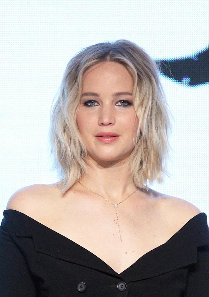<p>This bob, styled for a press conference in Beijing, is undeniably one of J Law's best looks – particularly in soft blonde hue. [Photo: Getty] </p>