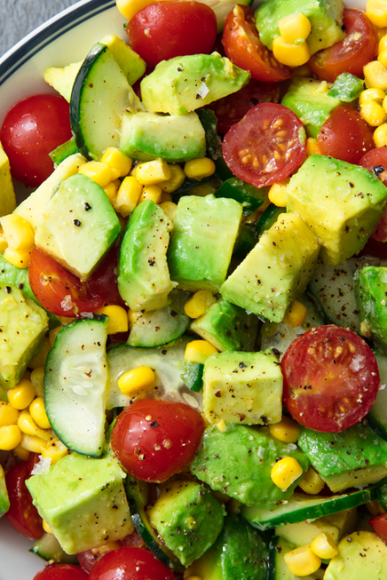 "<p>Don't confuse this with guac—there's way more depth of flavour, which makes it one of our favourite summer sides of all time. But the real beauty? You're totally welcome to eat it with tortilla crisps. (Just know it tastes amazing without 'em.)</p><p>Get the <a href=""https://www.delish.com/uk/cooking/recipes/a29842914/avocado-tomato-salad-recipe/"" target=""_blank"">Avocado & Tomato Salad</a> recipe.</p>"