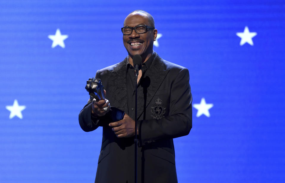 Eddie Murphy accepts the lifetime achievement award at the 25th annual Critics' Choice Awards on Sunday, Jan. 12, 2020, at the Barker Hangar in Santa Monica, Calif. (AP Photo/Chris Pizzello)
