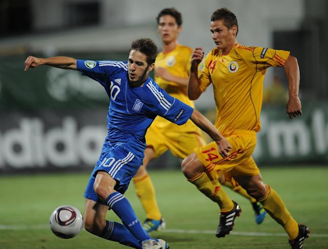 Ionut Gugu (R) of Romania vies for the ball with Kostas Fortounis (L) of Greece during the final football match of the UEFA European Under-19 Championship 2010/2011 in Berceni village next to Bucharest July 23, 2011. Greece won 1-0. AFP PHOTO/DANIEL MIHAILESCU (Photo credit should read DANIEL MIHAILESCU/AFP/Getty Images)