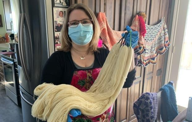 The beautiful raw wool yarn is a blank canvas for Moore, who sells her hand-dyed yarn in several P.E.I. knitting shops.