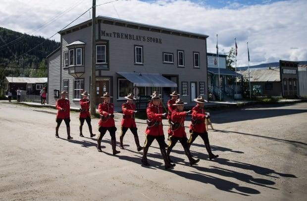 Dawson City's Canada Day parade in 2018. The town's events have been cancelled this year, with the funds set to go to the Yukon government to help pay for investigations of residential schools.  ( - image credit)