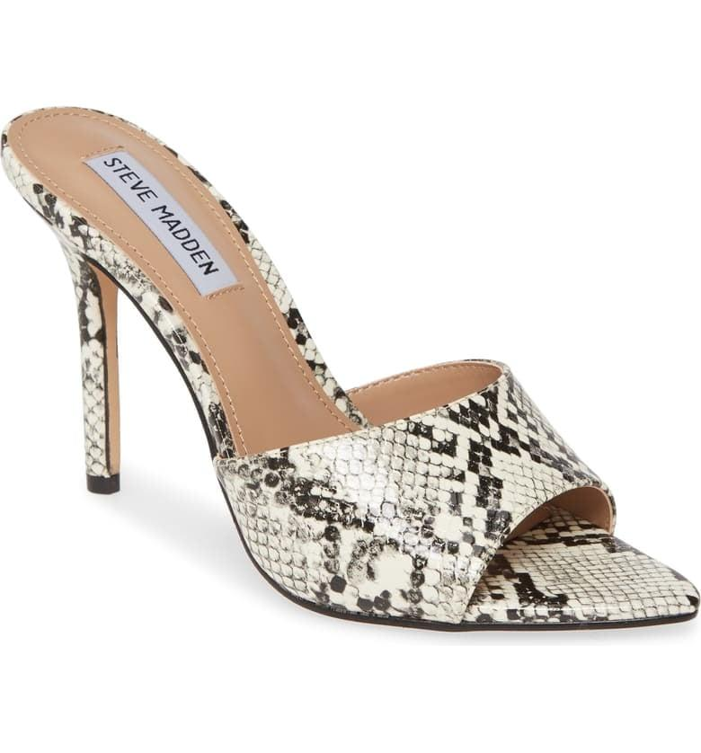 """<p>These fun <a href=""""https://www.popsugar.com/buy/Steve-Madden-Feisty-Slide-Sandals-494330?p_name=Steve%20Madden%20Feisty%20Slide%20Sandals&retailer=shop.nordstrom.com&pid=494330&price=90&evar1=fab%3Aus&evar9=46678981&evar98=https%3A%2F%2Fwww.popsugar.com%2Ffashion%2Fphoto-gallery%2F46678981%2Fimage%2F46678990%2FSteve-Madden-Feisty-Slide-Sandal&list1=shopping%2Cgifts%2Cnordstrom%2Cgift%20guide%2Cgifts%20for%20women&prop13=mobile&pdata=1"""" rel=""""nofollow"""" data-shoppable-link=""""1"""" target=""""_blank"""" class=""""ga-track"""" data-ga-category=""""Related"""" data-ga-label=""""https://shop.nordstrom.com/s/steve-madden-feisty-slide-sandal-women/5437242?origin=category-personalizedsort&amp;breadcrumb=Home%2FWomen%2FShoes&amp;color=white%2F%20black"""" data-ga-action=""""In-Line Links"""">Steve Madden Feisty Slide Sandals</a> ($90) are easy to pair with so many looks.</p>"""