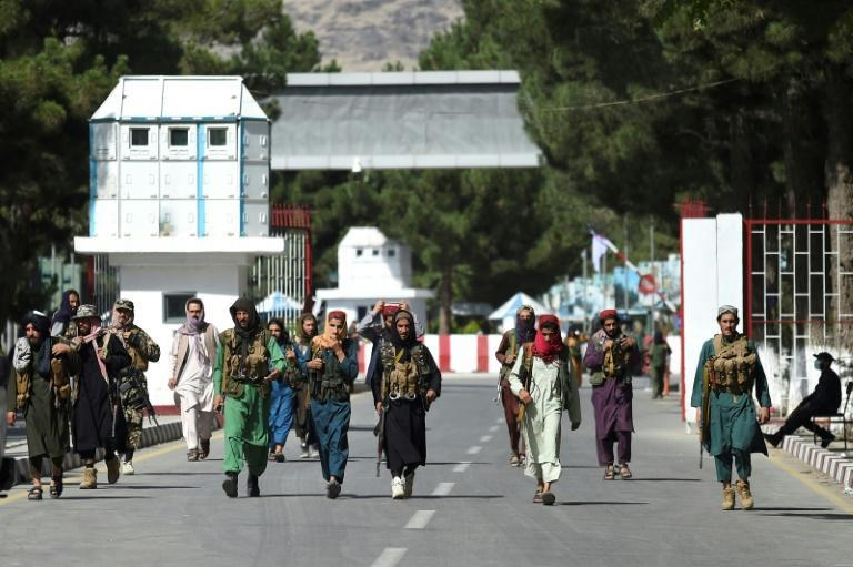 Taliban fighters in the grounds of Kabul's airport (AFP/WAKIL KOHSAR)