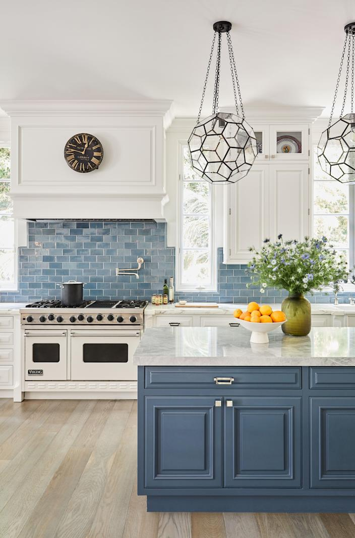 """""""I am a terrible cook, but yet I love a beautiful kitchen,"""" says Melissa Rivers, who tapped designer Martyn Lawrence Bullard to oversee the top-down redesign of her Mediterranean-style home in Santa Monica, California. The original kitchen just needed a pick-me-up. The high-end appliances were in great shape, so Rivers decided to make the room her own by adding blue: a blue backsplash, blue tiles, and blue cabinets. This particular blue relates to a hue found in a Robert Rauschenberg painting that also hangs in the kitchen. """"As much as I love a neutral room, the kitchen and the family room just need some color,"""" she says. """"It just wakes things up. In L.A., you just see these kitchens that are all white, all the time."""""""
