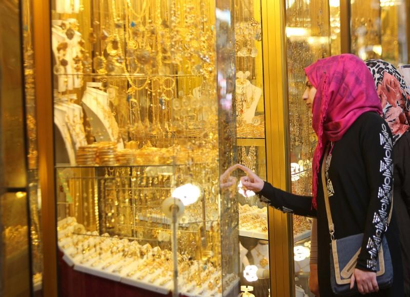 Women look at jewellery at a shop in a gold market in Basra, southeast of Baghdad