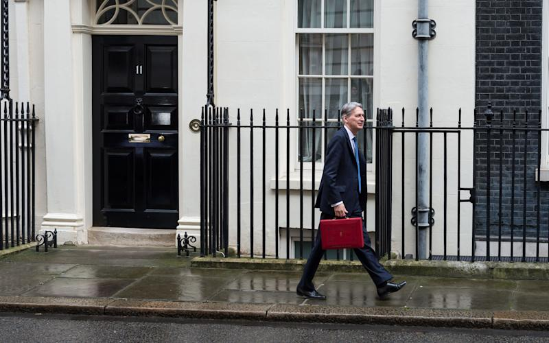 Philip Hammond on the way to deliver the budget - Wiktor Szymanowicz / Barcroft Media