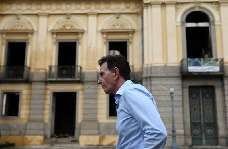 FILE PHOTO: Rio de Janeiro's Mayor Marcelo Crivella walks outside the National Museum of Brazil in Rio de Janeiro