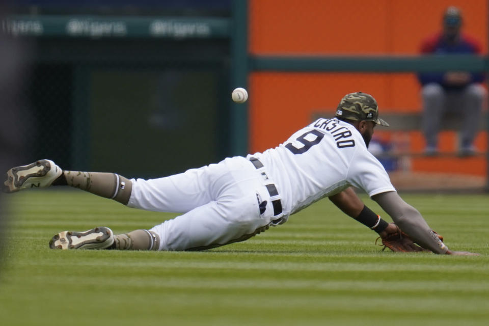 Detroit Tigers' Willi Castro dives but can't reach a Chicago Cubs' Ian Happ fly ball in the fourth inning of a baseball game in Detroit, Sunday, May 16, 2021. (AP Photo/Paul Sancya)