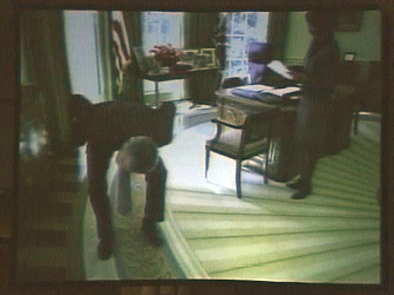"""FILE - In this March 24, 2004, file photo taken from video, President George W. Bush appears to search the Oval Office for weapons of mass destruction in a spoof video shown at the White House radio and television correspondents dinner in Washington. Bush narrated the video at the dinner and quipped, """"Those weapons of mass destruction gotta be somewhere."""" Critics said it was a callous and cynical joke, given all those who had died in the Iraq war. (AP Photo/ APTN Pool, File)"""
