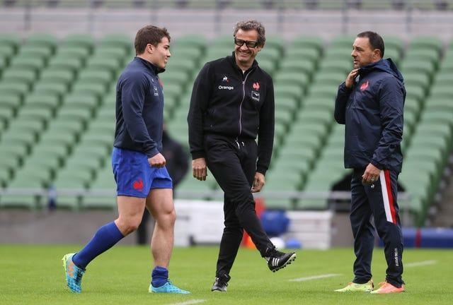 Antoine Dupont, left, has been a key player for France under head coach Fabien Galthie, centre, and team manager Raphael Ibanez, right