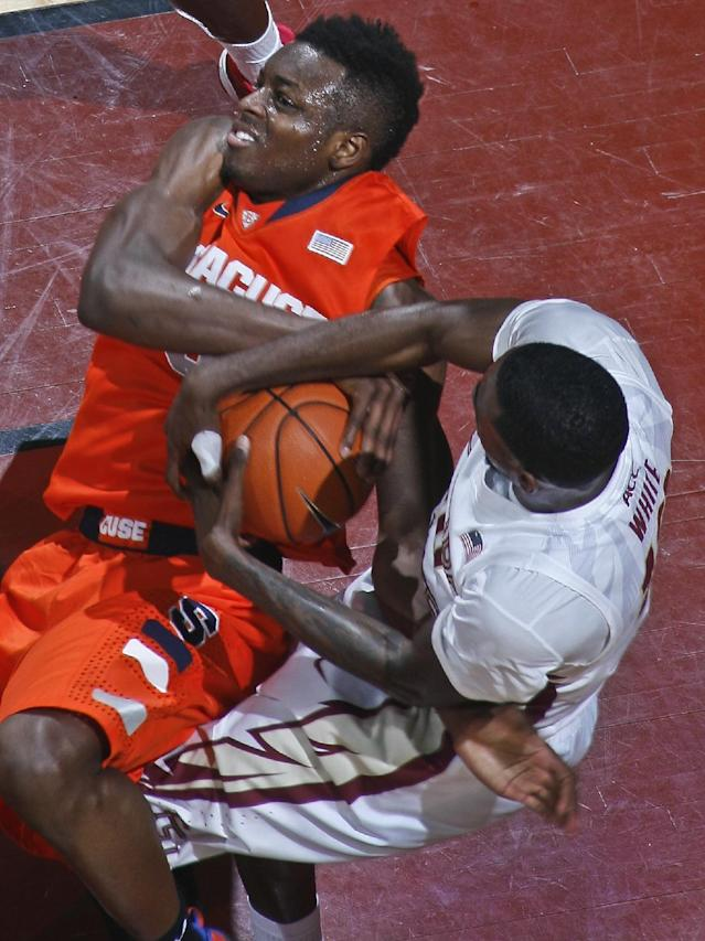 Florida State forward Okaro White, right, gets Syracuse forward Jerami Grant, left, into a jump ball call in the first half of an NCAA college basketball game on Sunday, March 9, 2014, in Tallahassee, Fla. Syracuse defeated Florida State 74-58. (AP Photo/Phil Sears)
