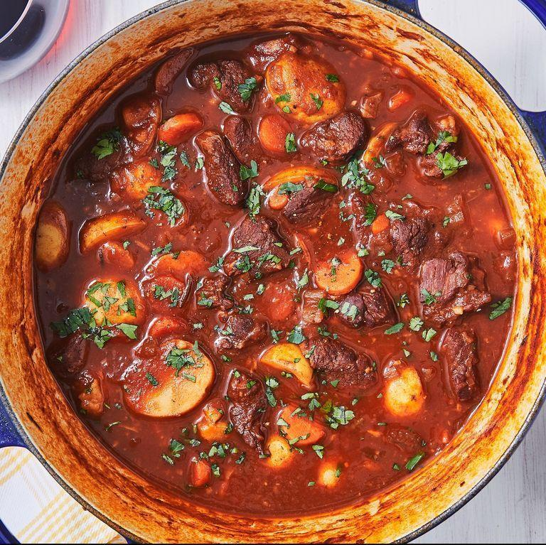 """<p>You might be wondering where the flour is in this recipe is. We've got good news: you don't need it! When the potatoes are added, they release their natural starches, which just so happen to be very good at thickening the stew. The resulting stock is velvety smooth and super flavourful.</p><p>Get the <a href=""""https://www.delish.com/uk/cooking/recipes/a30146079/lamb-stew-recipe/"""" rel=""""nofollow noopener"""" target=""""_blank"""" data-ylk=""""slk:Lamb Stew"""" class=""""link rapid-noclick-resp"""">Lamb Stew</a> recipe.</p>"""