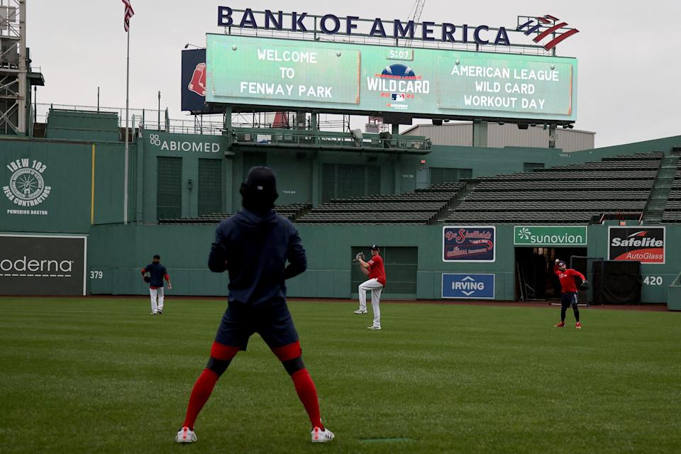 Red Sox players warm up at Fenway Park the day before the AL wild-card game against the Yankees.