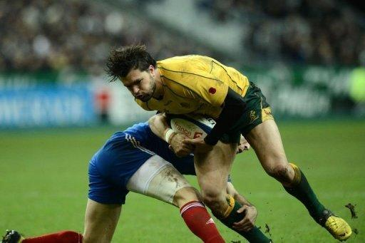 Australia's wing Adam Ashley-Cooper (R) is tackled by France scrum half Morgan Parra