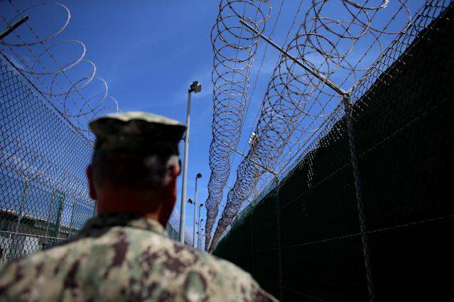 GUANTANAMO BAY, CUBA - JUNE 26: (EDITORS NOTE: Image has been reviewed by the U.S. Military prior to transmission.) Razor wire is seen on the fence around Camp Delta which is part of the U.S. military prison for 'enemy combatants' on June 26, 2013 in Guantanamo Bay, Cuba. President Barack Obama has recently spoken again about closing the prison which has been used to hold prisoners from the invasion of Afghanistan and the war on terror since early 2002. (Photo by Joe Raedle/Getty Images)