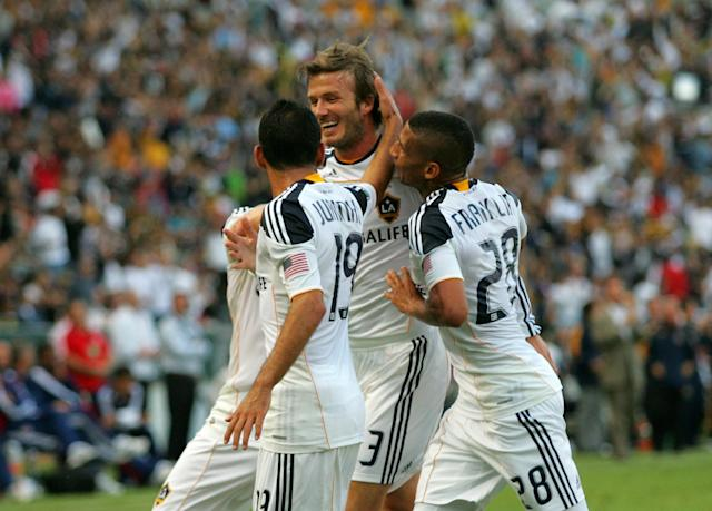 CARSON, CA - OCTOBER 03: David Beckham #23 of the Los Angeles Galay celebrates his first half goal with teammates Juninho #19 and Sean Franklin #28 in the first half during the MLS match against Chivas USA at The Home Depot Center on October 3, 2010 in Carson, California. (Photo by Victor Decolongon/Getty Images)