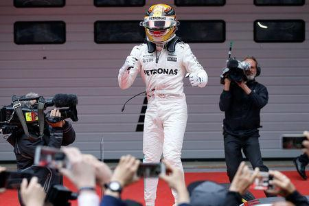 Formula One - F1 - Chinese Grand Prix - Shanghai, China - 09/04/17 - Mercedes driver Lewis Hamilton of Britain celebrates after winning the Chinese Grand Prix at the Shanghai International Circuit. REUTERS/Aly Song