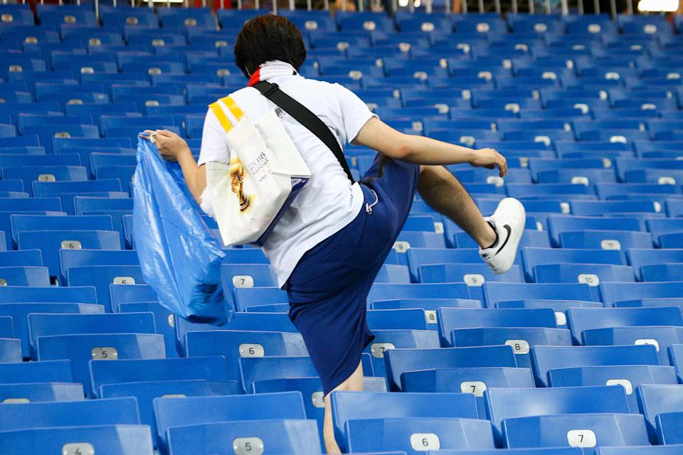 <p>Japan's supporter picking up litter after their 2018 FIFA World Cup Round of 16 football match against Belgium at Rostov Arena Stadium. Team Belgium won the game 3:2. Valery Matytsin/TASS (Photo by Valery Matytsin\TASS via Getty Images) </p>