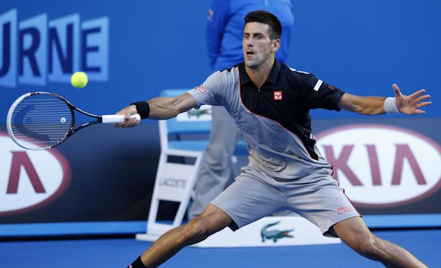 Novak Djokovic of Serbia makes a forehand return to Lukas Lacko of Slovakia during their first round match at the Australian Open tennis championship in Melbourne, Australia, Monday, Jan. 13, 2014.(AP Photo/Eugene Hoshiko)