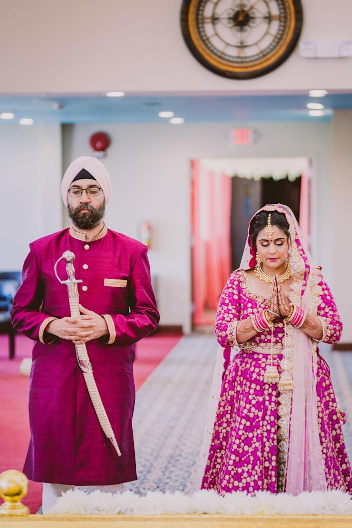 Rupam and Nitin doing Ardas, a prayer to seek blessings after the Sikh wedding ceremony, called the Anand Karaj. (A.S. Nagpal Photography)