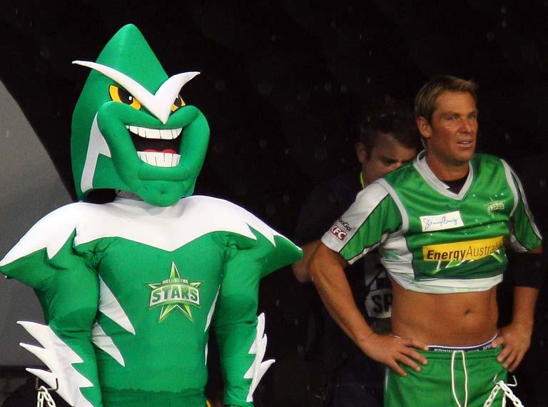 MELBOURNE, AUSTRALIA - JANUARY 07:  Shane Warne of the Stars is miked up for television as he stands next to the Stars mascot during the T20 Big Bash League match between the Melbourne Stars and the Melbourne Renegades at the Melbourne Cricket Ground on January 7, 2012 in Melbourne, Australia.  (Photo by Scott Barbour/Getty Images)