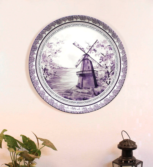 "In classic blue and white, this 7.5-inch, <a href=""https://fave.co/2XZse1m"" rel=""nofollow noopener"" target=""_blank"" data-ylk=""slk:bone china wall plate by Kolorobia"" class=""link rapid-noclick-resp""><strong>bone china wall plate by Kolorobia</strong></a> showcases delftware that's typical of Dutch and English earthenware. <em>Rs.1,199 on offer. </em><a href=""https://fave.co/2XZse1m"" rel=""nofollow noopener"" target=""_blank"" data-ylk=""slk:Flash sale!"" class=""link rapid-noclick-resp""><strong>Flash sale!</strong></a>"