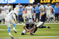 Dallas Cowboys kicker Greg Zuerlein makes the game-winning field goal as time expires during the second half of an NFL football game against the Los Angeles Chargers Sunday, Sept. 19, 2021, in Inglewood, Calif. (AP Photo/Ashley Landis)